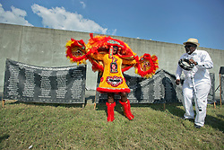 29 August 2015. Lower 9th Ward, New Orleans, Louisiana.<br /> Hurricane Katrina 10th anniversary memorial.<br /> Mary Kay, second Queen of the Wild Tchoupitoulas Mardi Gras Indians at the levee wall which gave way a decade earlier. <br /> Photo credit©; Charlie Varley/varleypix.com.