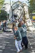 Emma Thompson (pictured pulling Aurora), and Greenpeace UK Executive Director John Sauven, deliver a celebration speech to crowds outside Shell's offices – in response to yesterday's announcement by , the Anglo-Dutch oil major, Shell that it was pulling out of Arctic oil drilling. After speaking, Emma helped volunteer puppeteers move Aurora the double decker bus sized polar bear from in front of Shell's front door.  The bear has been standing there  for the past month, in protest at Shell's proposed Arctic oil drilling. Now Shell has announced its Arctic exit, the bear will be transported to Paris where the nations of the world will soon gather to negotiate a deal on climate change.