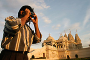 Tourist at the Shri Swaminaraya Mandir, Neasden, UK. Opened in 1995, the temple is the first traditional Mandir in the UK.