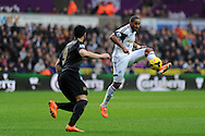 Swansea city's Ashley Williams ® gets to the ball ahead of Man city's  Alvaro Negredo.  Barclays Premier league, Swansea city v Manchester City at the Liberty Stadium in Swansea,  South Wales on  New years day Wed 1st Jan 2014 <br /> pic by Andrew Orchard, Andrew Orchard sports photography.