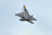 F-22A in vertical climb with afterburner.