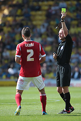 Nottingham Forest's Eric Lichaj receives a yellow card from  referee Oliver Langford   - Photo mandatory by-line: Nigel Pitts-Drake/JMP - Tel: Mobile: 07966 386802 25/08/2013 - SPORT - FOOTBALL -Vicarage Road Stadium - Watford -  Watford v Nottingham Forest - Sky Bet Championship