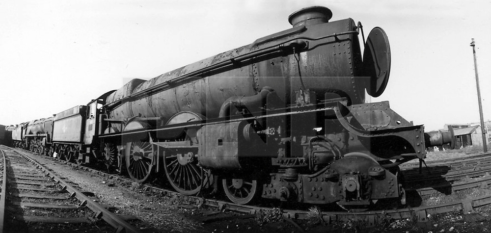 © under license to London News Pictures. 02/04/2011. The King Edward II steam locomotive pictured at Barry scrapyard in 1971. The KEII was today (02/04/2011) revealed to the public in it's full glory at the Railway Centre in Didcot, Oxfordshire, England. A group of volunteer workers have spent the last 20 years working on restoring the heavy express steam locomotive to full working order. The splendid machine first introduced in the 1920's spent many years rotting at Barry Scrapyard in Wales after performing over 1,500,000 miles of service pulling trains between London Paddington and the West of England for Great Western Railway. Photo credit should read: London News Pictures