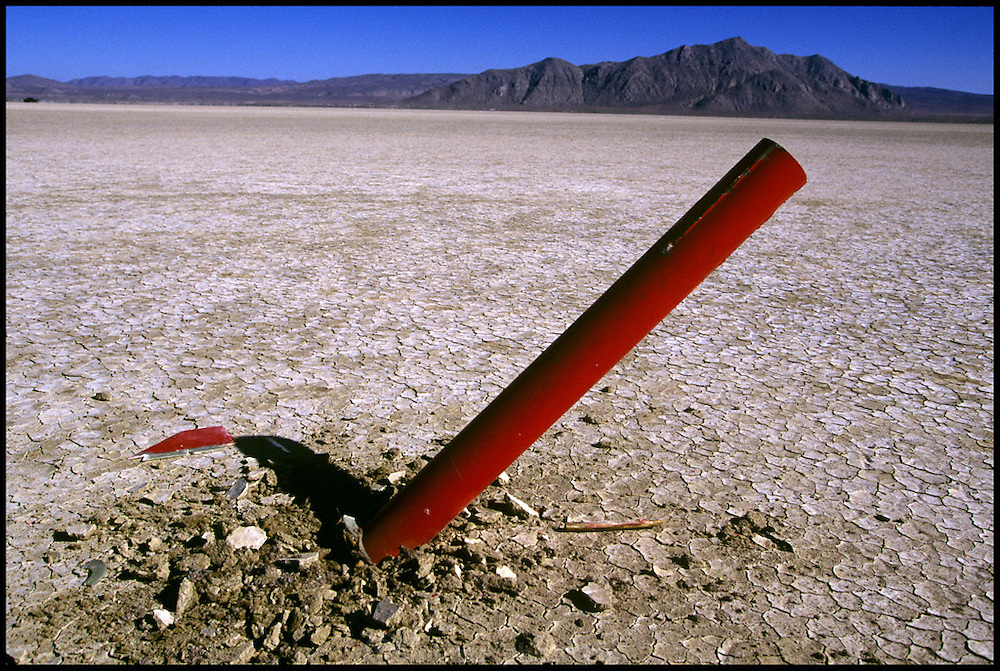Amateur rocket launch. Deep impact. The parachute of a rocket failed to open, leading to a hard landing during the annual Black Rock X amateur rocketry event in the Black Rock desert, Nevada, USA. This huge flat expanse of land is a popular launch site for large and powerful amateur rockets as it is far from civilization and has little natural animal or plant life. .