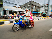 15 JUNE 2105 - NARATHIWAT, NARATHIWAT, THAILAND: People on motorcycles in the market in Narathiwat.       PHOTO BY JACK KURTZ