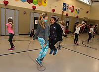 Melody Goyette and Kendora Harper-Cartier double jump during Elm Street School's annual Jump Rope for Heart event Friday morning.  (Karen Bobotas/for the Laconia Daily Sun)