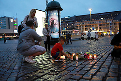 (170818) -- TURKU (FINLAND), Aug. 18, 2017 (Xinhua) -- People mourn victims of the stabbing attacks in Turku, southwestern Finland, on Aug. 18, 2017. Several people were stabbed in downtown Turku, southwestern Finland on Friday, when more than one man mounted the attacks simultaneously. At least two died and eight others were injured, according to local media. (Xinhua/Zhang Xuan)  (Photo by Xinhua/Sipa USA)