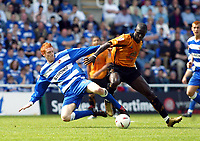 Fotball<br /> England 2004/2005<br /> Foto: SBI/Digitalsport<br /> NORWAY ONLY<br /> <br /> Reading v Wolverhampton Wanderers<br /> Coca Cola Championship. 30/04/2005<br /> <br /> Dave Kitson of Reading gets the ball away from Seyi Olofinjana of Wolves