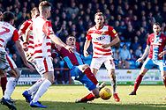 Scunthorpe United forward Lee Novak (17) stabs the ball in the box during the EFL Sky Bet League 1 match between Scunthorpe United and Doncaster Rovers at Glanford Park, Scunthorpe, England on 23 February 2019.