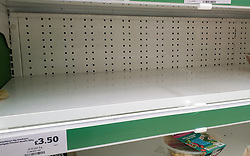 © Licensed to London News Pictures. 19/08/2021. London, UK. An empty shelf of pre-cooked chicken meals in Sainsbury's supermarket in London. Supermarkets, pubs,  restaurants and fast food chains are facing chicken shortages. According to the British Poultry Council there is a significant shortage of workers across the farming and processing sectors with many businesses reporting an average vacancy rate of over 16% as a result of workers leaving the UK due to Brexit. Photo credit: Dinendra Haria/LNP