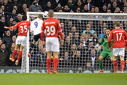 Tottenham's Roberto Soldado heads the ball towards the Cardiff goal - Photo mandatory by-line: Mitchell Gunn/JMP - Tel: Mobile: 07966 386802 02/03/2014 - SPORT - FOOTBALL - White Hart Lane - London - Tottenham Hotspur v Cardiff City - Premier League
