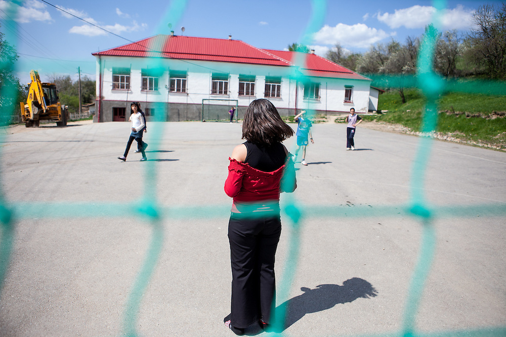 School children playing soccer in mixed girl and boy teams behind the  local kindergarten and school in the city of Crnik, Macedonia.