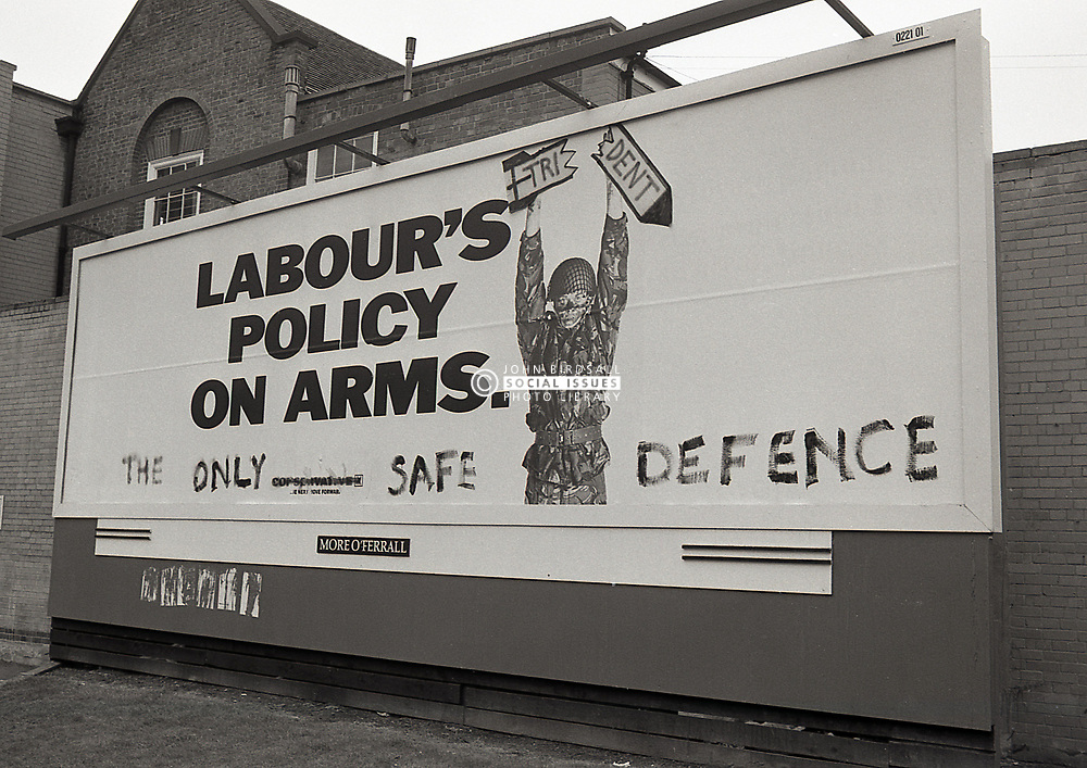 Conservative advertising hoarding trashing Labour Party's defence policy with anti-Tory graffiti on it, Nottingham UK 1987