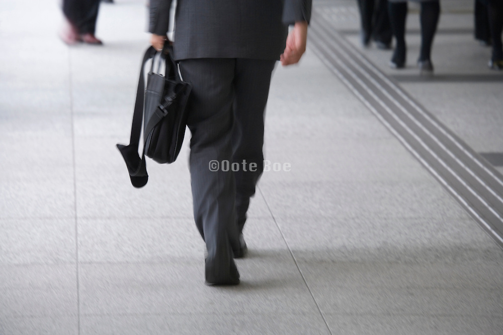 businessmen walking