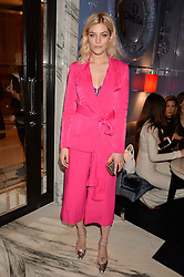 LONDON, ENGLAND 8 DECEMBER 2016: Amber Anderson at the Omega Constellation Globemaster Dinner at Marcus, The Berkeley Hotel, Wilton Place, London England. 8 December 2016.