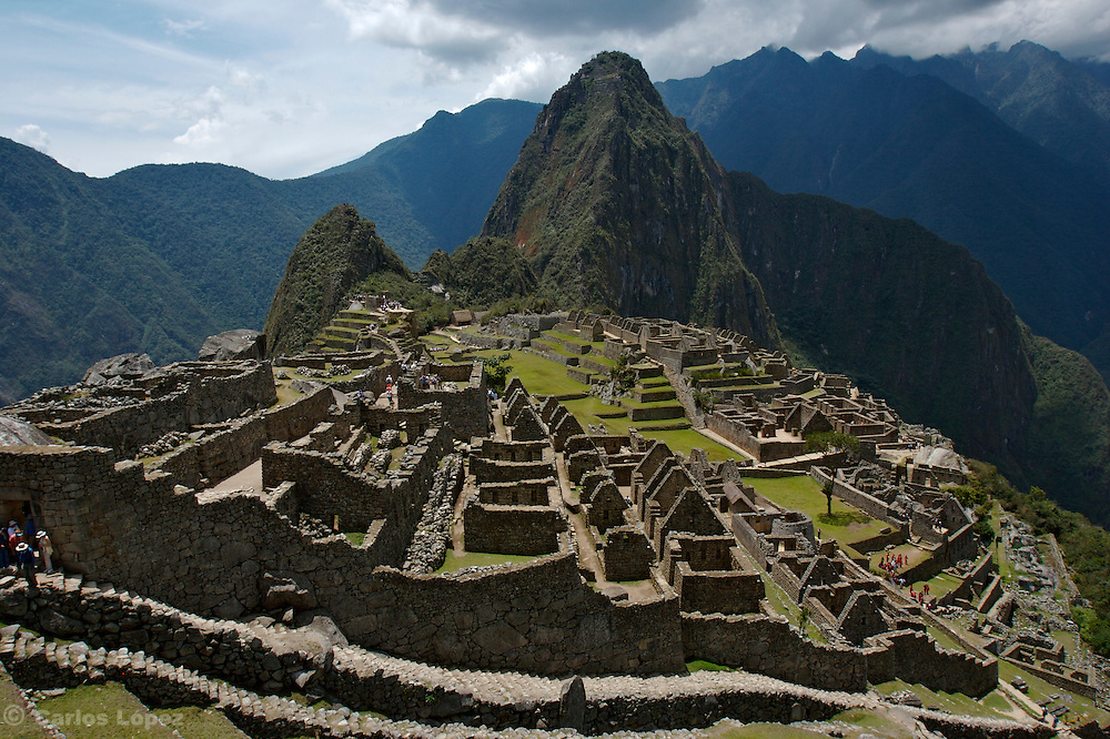 A general view of  Machu Picchu, a  fortified Inca town in the Andes Mountains in Peru that the invading Spaniards never found. It is noted for its dramatic position, perched high on a steep-sided ridge. Now it is  one of the new seven wonders o the modern worl.