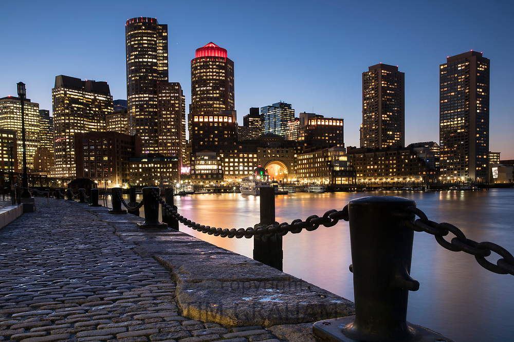 Cityscape of skyscrapers and high rise buildings of city of Boston, Massachusetts at night, USA
