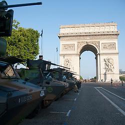 Véhicules et VAB de l'armée de terre stationnés sur l'avenue des Champs Elysées à l'occasion des célébrations de la fête nationale.<br /> 14 juillet 2013, Paris (75)