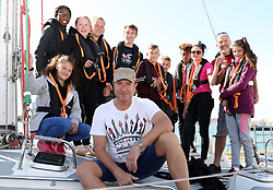 Simon Le Bon poses for a photograph alongside the Tall Ships Youth Trust team on board a 72 foot Challenger yacht after arriving back in Gunwarf Quays in Portsmouth after racing in the Solent.