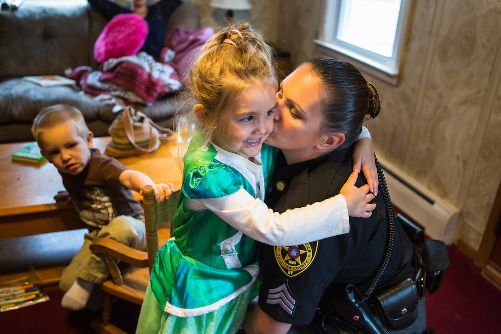 Sergeant Crumley embraces her daughter Taylor as Andre waits for her attention.