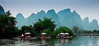 The Dragon River near Yangshuo is a popular destination for taking a bamboo raft ride through the picturesque Yulong River valley.