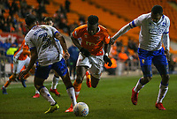 Blackpool's Armand Gnanduillet battles with Mansfield Town's Mal Benning and Krystian Pearce<br /> <br /> Photographer Alex Dodd/CameraSport<br /> <br /> The EFL Checkatrade Trophy Second Round - Blackpool v Mansfield Town - Wednesday 6th December 2017 - Bloomfield Road - Blackpool<br />  <br /> World Copyright © 2018 CameraSport. All rights reserved. 43 Linden Ave. Countesthorpe. Leicester. England. LE8 5PG - Tel: +44 (0) 116 277 4147 - admin@camerasport.com - www.camerasport.com