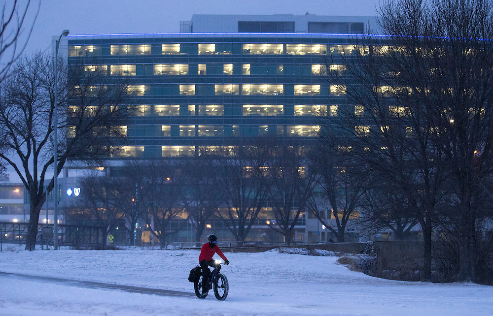 """Ken Curran commutes home in the evening snow at Arksarben on Monday, Jan. 25, 2016, in Omaha. """"I hate to miss,"""" said Curran about cycling."""
