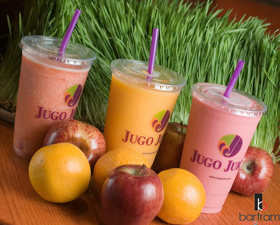 KEVIN BARTRAM/The Daily News.Three flavors of Jugo Juice are displayed at the company's store inside Baybrook Mall on Friday, June 9, 2006. They are, from left, Righteous Red, Mango Magic and Summer Strawberry. Wheat grass and fruits are used to make the drinks. The Baybrook location is the company's first franchise store outside of Canada where they have about 60 stores.