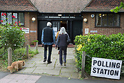 Dog owning voters arrive for the UK 2017 general elections outside the polling station at St. Barnabas Parish Hall in Dulwich Village  on 8th June 2017, in London, England.
