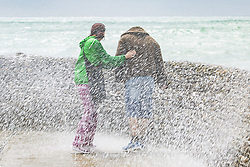 June 25, 2017 - Brighton, East Sussex, United Kingdom - Brighton, UK. Members of the public are being drenched by powerful waves hitting the pontoon on Brighton and Hove beach. (Credit Image: © Hugo Michiels/London News Pictures via ZUMA Wire)