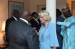 The Duchess of Cornwall meets guests attending a Commonwealth reception at the British High Commissioner's residence in Abuja, Nigeria, on day seven of the royal trip to west Africa.