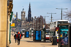 People on Princes Street. Edinburgh on the day after the Lockdown.