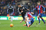 Diego Costa of Chelsea goes past Mile Jedinak, the Crystal Palace captain. Barclays Premier League match, Crystal Palace v Chelsea at Selhurst Park in London on Sunday 3rd Jan 2016. pic by John Patrick Fletcher, Andrew Orchard sports photography.