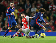 Arsenal's Mikel Arteta tussles with Manchester United's Marouane Fellaini<br /> <br /> Barclays Premier League- Arsenal vs Manchester United - Emirates Stadium - England - 22nd November 2014 - Picture David Klein/Sportimage
