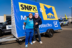 Edinburgh, Scotland, UK. 24 April 2021. Campaigners for the SNP party wear masks of Nicola Sturgeon and Alex Salmond when posing beside SNP ad van Wester Hailes in Edinburgh today. Iain Masterton/Alamy Live News