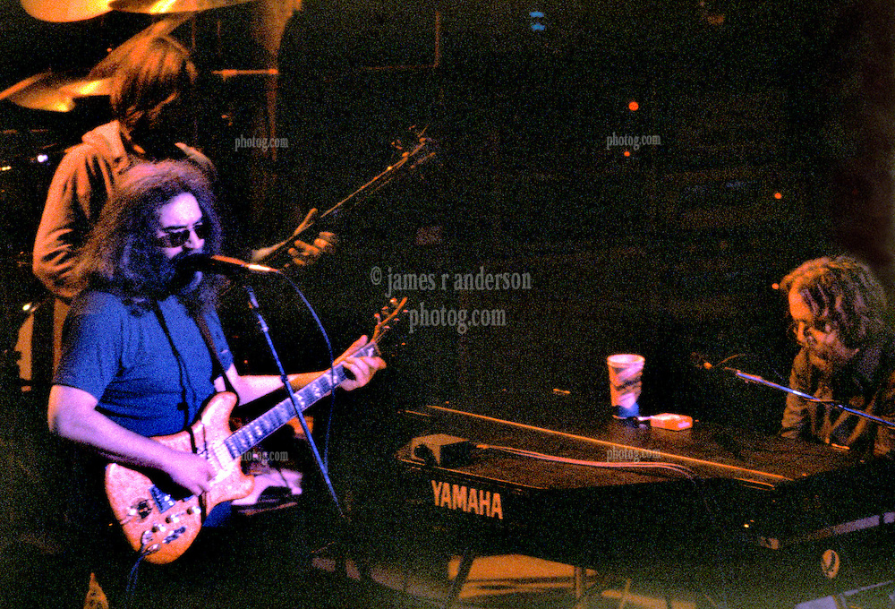 Grateful Dead at Shea's Buffalo Theater New York 20 January 1979. Phil Lesh, background left, Jerry Garcia foreground left, and Keith Godchaux, right at piano.