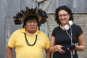 Corinne Moutout, journalist with Chief Almir  Narayamogo of the Surui tribe<br /><br />An Amazonian tribal chief Almir Narayamogo, leader of 1350 Surui Indians in Rondônia, near Cacaol, Brazil, with a $100,000 bounty on his head, is fighting for the survival of his people and their forest, and using the world's modern hi-tech tools; computers, smartphones, Google Earth and digital forestry surveillance. So far their fight has been very effective, leading to a most promising and novel result. In 2013, Almir Narayamogo, led his people to be the first and unique indigenous tribe in the world to manage their own REDD+ carbon project and sell carbon credits to the industrial world. By marketing the CO2 capacity of 250 000 hectares of their virgin forest, the forty year old Surui, has ensured the preservation, as well as a future of his community. <br /><br />In 2009, the four clans and 25 Surui villages voted in favour of a total moratorium on logging and the carbon credits project. <br /><br />They still face deforestation problems, such as illegal logging, and gold mining which causes pollution of their river systems