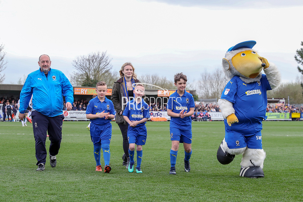 Mascot and Haydon the Womble running off the pitch during the EFL Sky Bet League 1 match between AFC Wimbledon and Gillingham at the Cherry Red Records Stadium, Kingston, England on 23 March 2019.