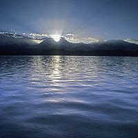 The sun rises over Lake Karakul and the Pamir Mountains in Xinjiang province, China.