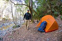 Hiker walks through Sykes Hot Springs, Big Sur, California.