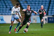 Morecambe  forward, on loan from Tranmere Rovers, Cole Stockton (23)  takes on Coventry City defender Cian Harries (29) during the The FA Cup match between Coventry City and Morecambe at the Ricoh Arena, Coventry, England on 15 November 2016. Photo by Simon Davies.