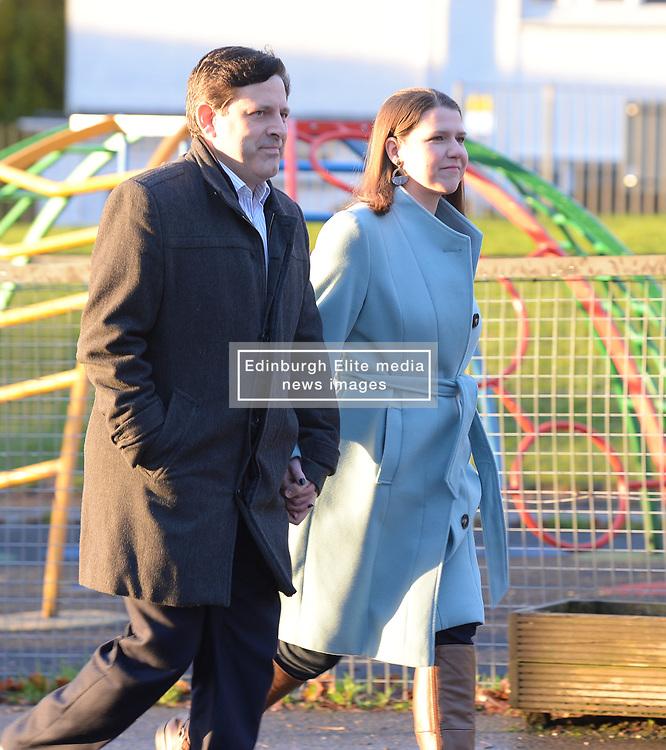 Liberal Democrat leader Jo Swinson casts her vote in Bearsden, Glasgow with husband Duncan Hames.<br /> <br /> © Dave Johnston / EEm