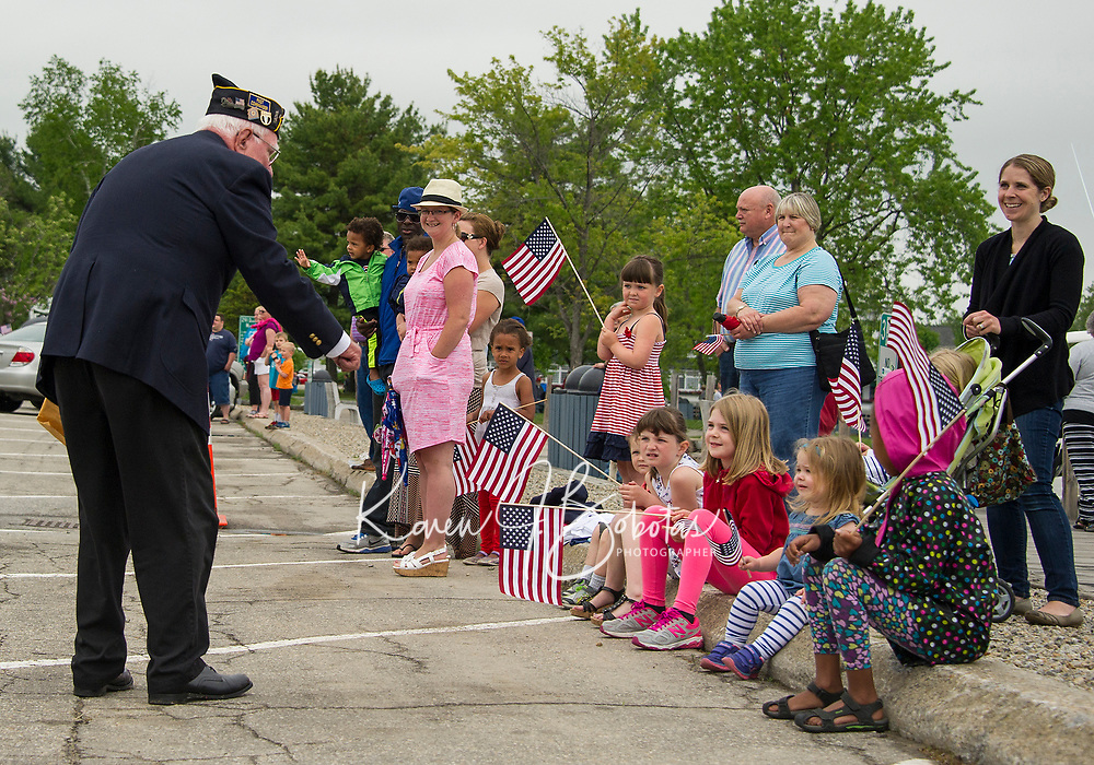 Commander of VFW Post 33 is greeted by a group of youngsters along the parade route from Main Street to Hesky Park in Meredith during Memorial Day services.  (Karen Bobotas Photographer)