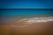 The sea at the fishing and holiday village of Salema, Algarve, Portugal