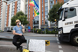 London, UK. 6th September, 2021. A human rights activist observes a heavy goods vehicle approaching ExCeL London as preparations take place for the DSEI 2021 arms fair. The first day of week-long Stop The Arms Fair protests outside the venue for one of the world's largest arms fairs was hosted by activists calling for a ban on UK arms exports to Israel.