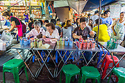 18 SEPTEMBER 2013 - BANGKOK, THAILAND: People eat at tables set up in the street in the Chinatown section of Bangkok. Thailand in general, and Bangkok in particular, has a vibrant tradition of street food and eating on the run. In recent years, Bangkok's street food has become something of an international landmark and is being written about in glossy travel magazines and in the pages of the New York Times.      PHOTO BY JACK KURTZ