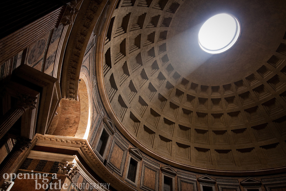 A sunbeam passes through the oculus of the domed Pantheon, Rome, Italy.