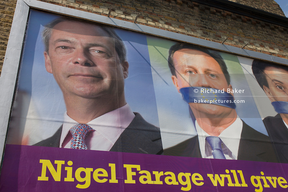 The anti-EU membership 'UK Independence Party's (UKIP) political billboard shows leader Nigel Farage, a gagged Prime Minister David Cameron and Labour party leader Ed Milliband  - both silent against a bullying European Union, seen in East Dulwich - a relatively affluent district of south London. The ad is displayed before European elections on 22nd May.