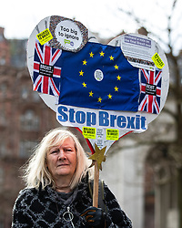 © Licensed to London News Pictures. 26/01/2019. Manchester, UK. A woman holds up a STOP BREXIT placard . A cross party demonstration by hundreds of supporters of a People's Vote on Britain's membership of the EU is held in St Peters Square , followed by a march to the Mechanics Institute and rally of supporters . Photo credit: Joel Goodman/LNP
