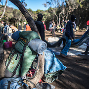 Porters pack up the campsite at Mweka Camp on Mt Kilimanjaro.
